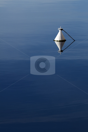 Buoy stock photo, Detail of a white buoy in a calm sea by Massimiliano Leban