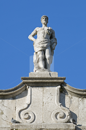 Statue stock photo, Statue on a building rooftop by Massimiliano Leban