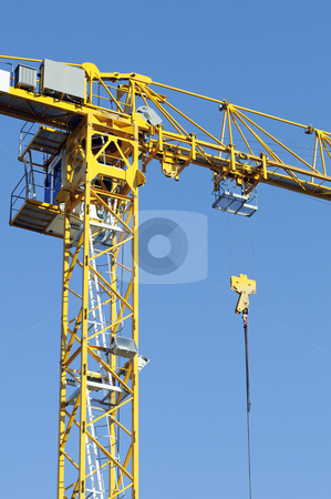 Crane stock photo, Yellow crane against a blue sky by Massimiliano Leban