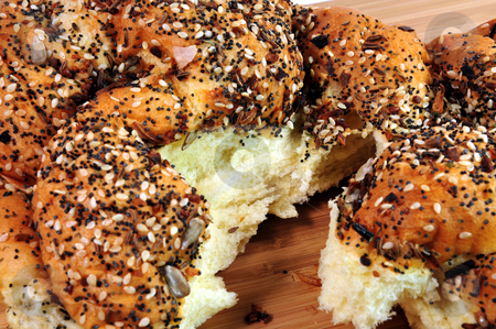 French Bread  Spilt Open stock photo, A loaf of artisan french bread topped with assorted seeds torn open to show the inside by Lynn Bendickson