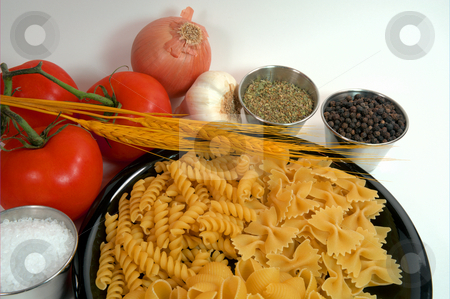 Pasta And Spices stock photo, Assorted dried pasta on a black plate with tomatoes , wheat stalks and spices by Lynn Bendickson