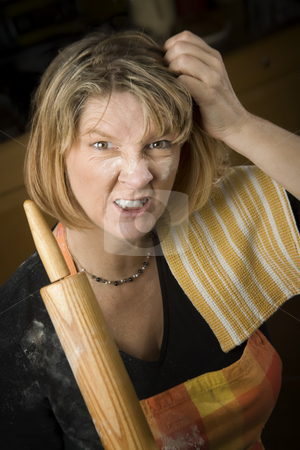 Frustrated Woman Baker stock photo, Frustrated Woman Baker with Rolling Pin Covered in Flour by Scott Griessel