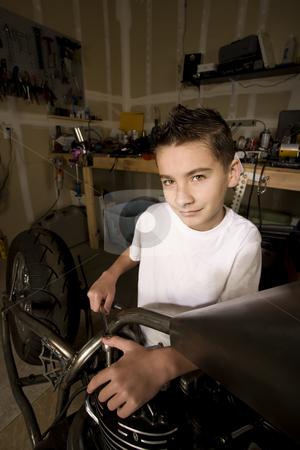 Boy Mechanic stock photo, Young Boy Mechanic Working on a Chopper Motorcycle by Scott Griessel