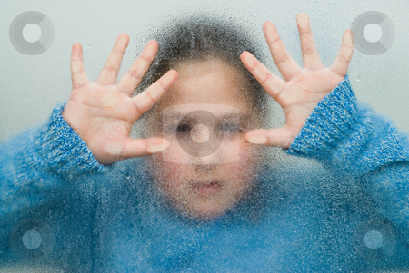 Trapped Girl stock photo, A young girl looking through some frosted glass by Richard Nelson