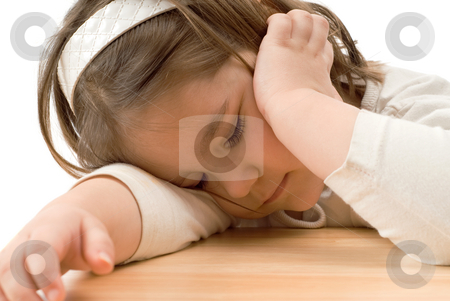 Sleeping Child stock photo, A young girl who fell asleep on a wooden desk by Richard Nelson