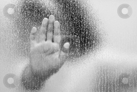 Child Abuse stock photo, A trapped child with her hand on the glass, shot in black and white by Richard Nelson
