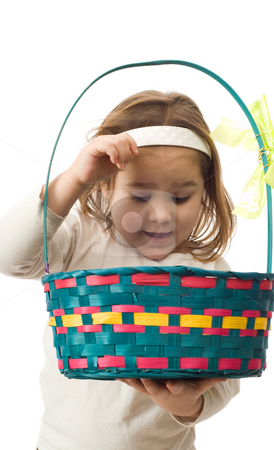 Easter stock photo, A young girl looking inside her Easter Basket, isolated against a white background by Richard Nelson