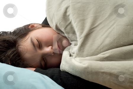 Sleeping Adolescent stock photo, Closeup view of a young girl covered with a blanket and sleeping by Richard Nelson