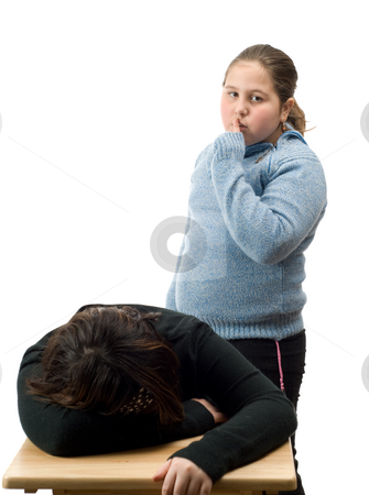 Sneaking stock photo, A young girl sneaking up on a friend while she is sleeping at a desk, isolated against a white background by Richard Nelson