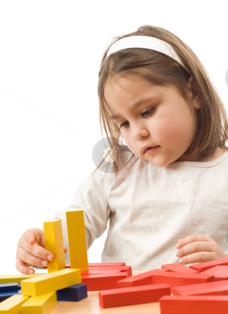 Child Playing stock photo, A young girl building something with some wooden blocks by Richard Nelson