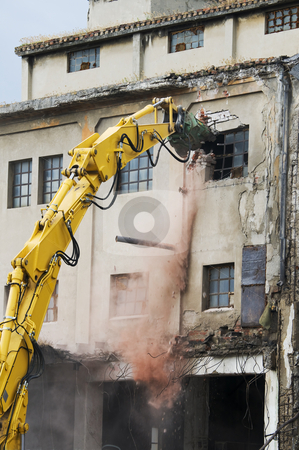 Demolition stock photo, Machinery working to demolish old building by Massimiliano Leban