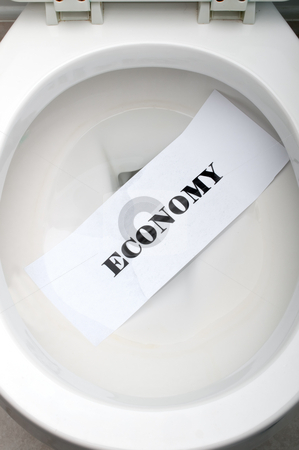 The word Economy in a white toilet stock photo, The word Economy on white paper in a white toilet by Vince Clements