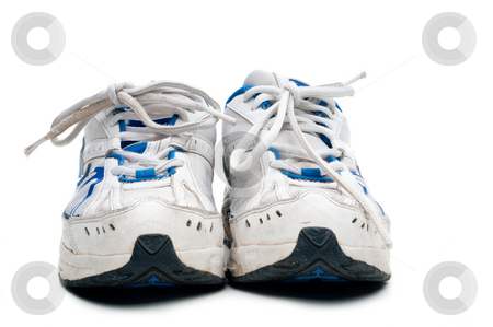 A pair of old worn athletic sports shoes on a white background stock photo, A pair of old worn athletic sports shoes on a white background by Vince Clements