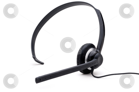 Telephone headset on a white background stock photo, Wired telephone headset on a white background by Vince Clements