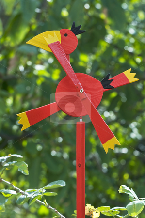 Weather vane stock photo, Red bird weather vane against the green by Massimiliano Leban