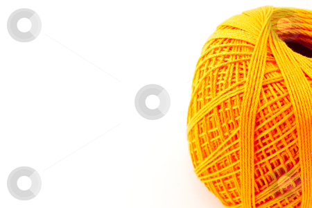 Orange wool clew3 stock photo, Orange wool clew with copy space by Santiago Hernandez