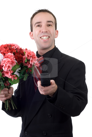 Man Proposing stock photo, A young man wearing a suit and holding a ring box and a bouquet of flowers, isolated against a white background by Richard Nelson