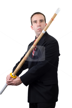 Sword Fight stock photo, A civilian sword fighter, wearing a formal suit and carrying his bamboo practice sword, isolated against a white background by Richard Nelson