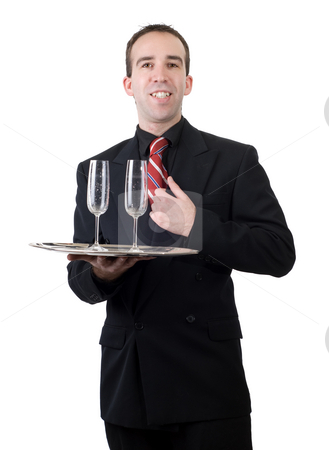 Formal Waiter stock photo, A young waiter wearing a suit and carrying away two empty wine glasses, all isolated against a white background by Richard Nelson