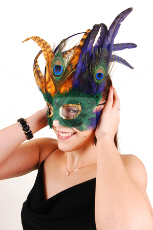 A lovely woman with a mask.  stock photo, A smiling young woman with an beautiful feather mask enjoying her picture taken. by Horst Petzold
