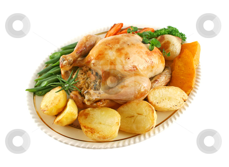 Roast Chicken stock photo, Whole roast chicken with potatoes pumkin carrots and beans. by Brett Mulcahy