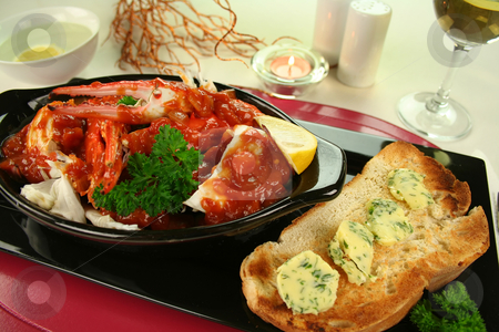 Cracked Crab In Tomato Sauce stock photo, Delicious fresh cracked sand crab in a spicy tomato sauce with toast and herb butter. by Brett Mulcahy