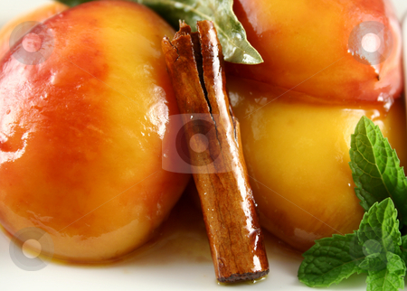 Poached Nectarines Background stock photo, Background of poached nectarines with honey syrup nut yogurt and a cinnamon stick. by Brett Mulcahy