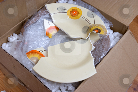 Bad packing stock photo, A valuable plate broken in shipping due to bad packing by Paul Phillips
