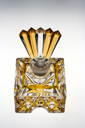 Antique perfume bottle stock photo, Glass antique perfume bottle in clear and yellow glass by Paul Phillips