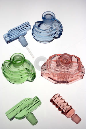 Antique scent bottles stock photo, Antique scent bottles in red, green and blue. Decorative glass by Paul Phillips