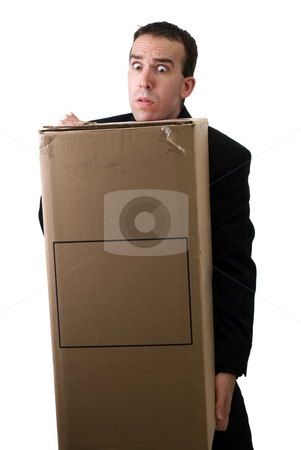 Heavy Box stock photo, A young man wearing a suit lifting a heavy box, isolated against a white background by Richard Nelson