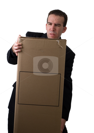 Struggling Businessman stock photo, A young businessman struggling to lift a box with your text on it by Richard Nelson