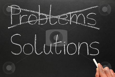 Crossing out problems and writing solutions on a blackboard. stock photo, Crossing out problems and writing solutions on a blackboard. by Stephen Rees