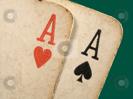 2 old dirty aces poker cards close up. stock photo, 2 old dirty aces poker cards close up. by Stephen Rees