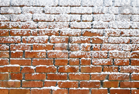 Snow sticking to an old brick wall. stock photo, Snow sticking to an old brick wall. by Stephen Rees