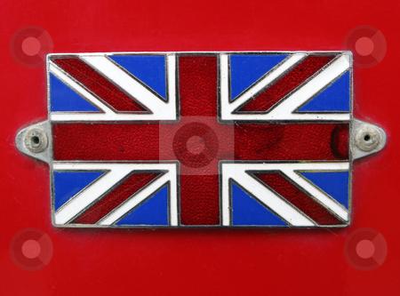 Vintage British Union Jack Flag badge on a red bus close up. stock photo, Vintage British Union Jack Flag badge on a red bus close up. by Stephen Rees