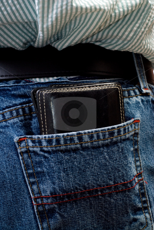 Closeup Wallet stock photo, A closeup view of a black wallet inside someone's back pocket by Richard Nelson