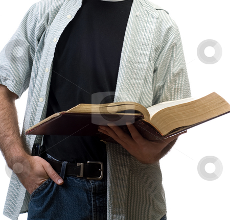 Reading The Bible stock photo, A young man reading the bible, isolated against a white background by Richard Nelson