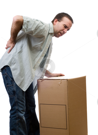 Back Injury stock photo, A man dressed in casual clothing, hurt his back lifting a large box, isolated against a white background by Richard Nelson