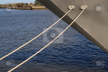 Moored Ship stock photo, Bow of a ship with two mooring lines attached to dock by Jack Schiffer