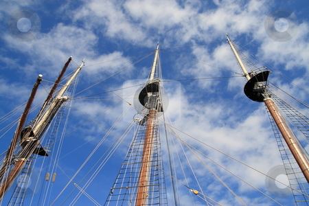 Masts stock photo, Three sailboat  masts in the clouds prospective by Jack Schiffer