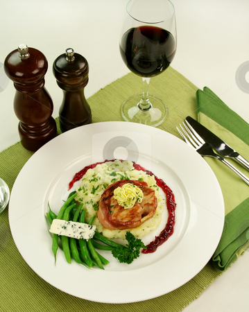 Chicken Fillet Mignon stock photo, Chicken fillet mignon on parsley mashed potato with green beans and blue cheese and red wine and raspberry jus. by Brett Mulcahy