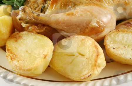 Chicken Drumstick And Potatoes stock photo, Chicken drumstick with fresh baked potatoes amd vegetables. by Brett Mulcahy