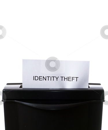 Identity Theft stock photo, Concept image of a shredder destroying personal information with copyspace above by Richard Nelson