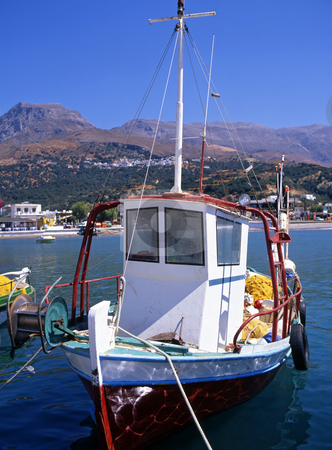 Small fishing boat stock photo, A small fishing boat moored on the Greek island of Kos by Paul Phillips