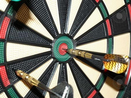 On the mark stock photo, Darts thrown at the board with one bullseye by Tim Markley