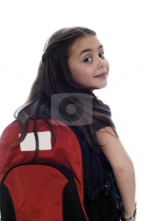 Happy young girl ready for school stock photo, Happy young girl ready for school against white background by Christopher Meder