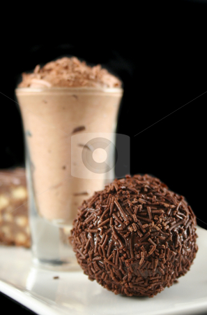 Triple Treat 2 stock photo, Triple chocolate treat of a rum ball and chocolate mousse and slice. by Brett Mulcahy