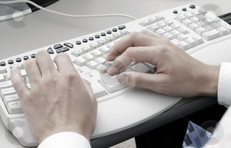 Typing on computer keyboard stock photo, Man typing on a computer keyboard by Christopher Meder