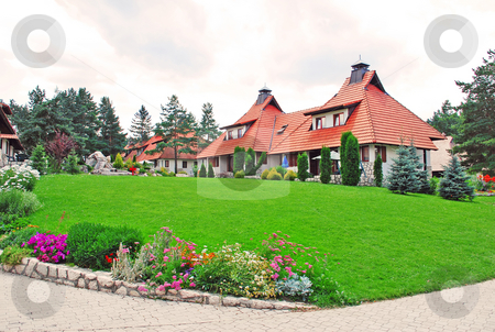 Cottage village - lawn stock photo, Weekend houses with gardens and stone road in Serbia, Zlatibor by Julija Sapic